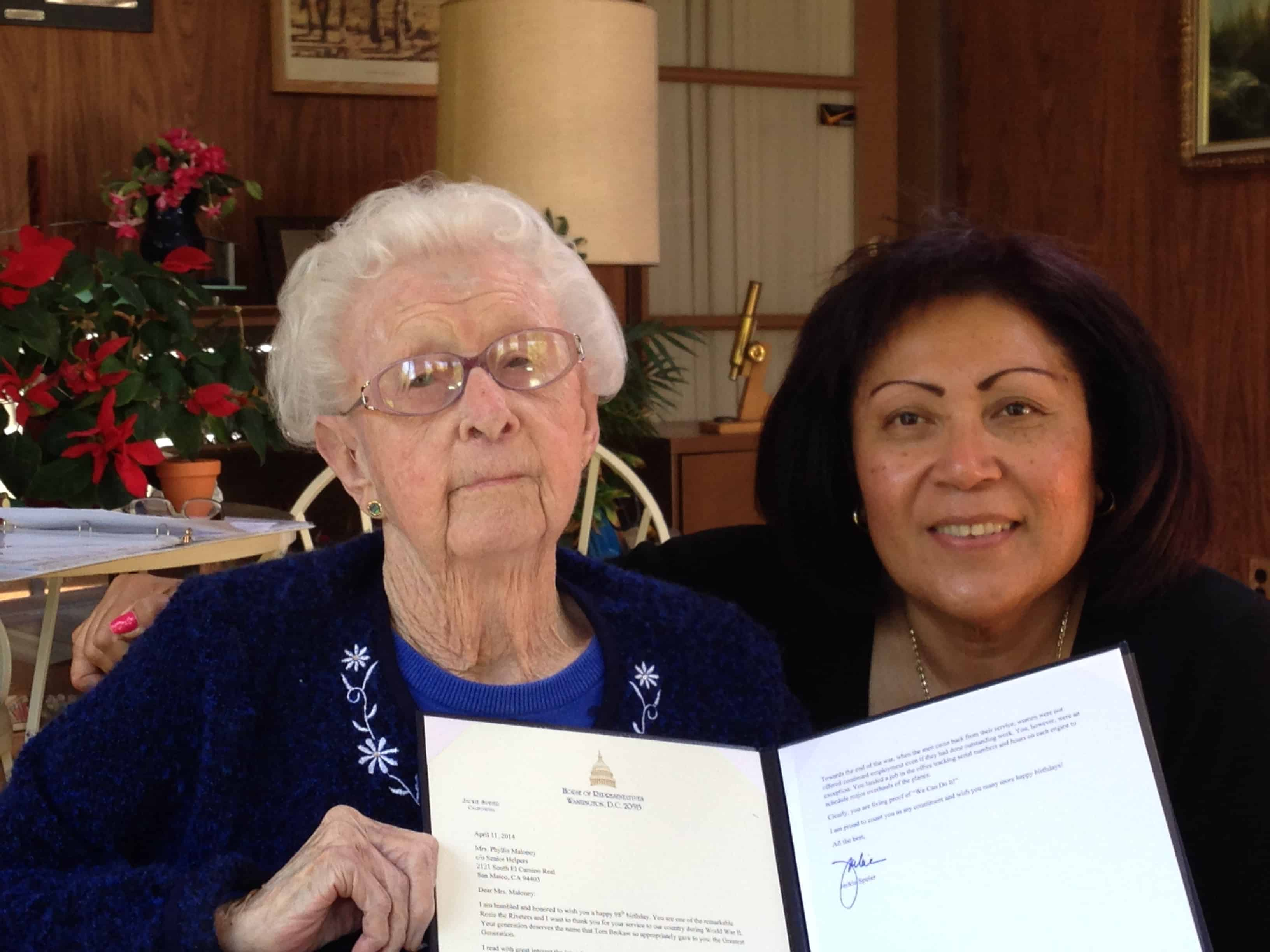 One of our clients, Phyllis, was recognized by our US representative to congress (Jackie Speier) for her work on airplanes during WWII. Phyllis is holding the official letter, on stationary from the US House of Representativesalong with her caregiver, Pafia.