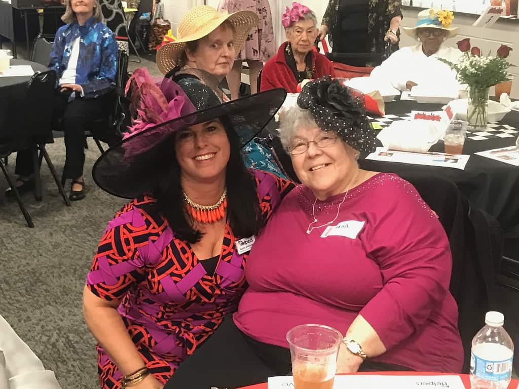 Owner, Nancy Galloway showing off her Derby hat with one of our great clients!